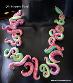 Oh Happy Day! A joy to wear, this pretty necklace is in rainbow coloured polymer clay squiggle beads that will make you want to sing, and dance - 22 long, with vintage lucite beads at the back for comfort - a holiday piece for the day and night. Design credit - Donna Kato and Polymer clay central
