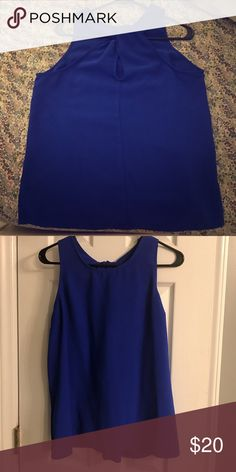 Royal blue racerback blouse Racer back blouse with cutout detail. Never worn. Skies Are Blue Tops Blouses