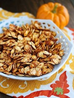 Salted caramel pumpkin seeds (and lots of other pumpkin seed recipes) | Pro tip: don't do the butter/sugar step until the seeds are already done and out of the oven, and toss them in AS SOON AS the mixture is ready, or the sugars will start to solidify on you. Still REALLY yummy, though!