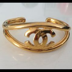 Authentic Chanel Gold Cuff Bracelet. This is a Authentic Chanel Cuff Bracelet. This was a gift given to me a few years ago and I never wear it. I am doing spring cleaning and found it in my jewelry box. This is a vintage piece. Very hard to find. Chanel Jewelry Bracelets