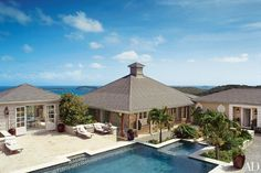 A young couple from England tapped architect Luboš Krácmar to design this 7,000-square-foot colonial-style residence on Mustique.
