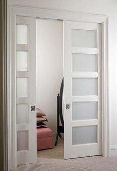Frosted pocket doors--if we closed off the patio to make an office, have these going from both bedrooms to office