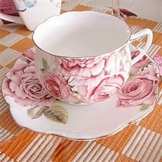 Teacup and Saucer - I can't walk through a gift shop without buying myself a new set.