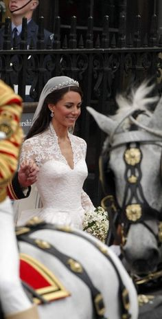 Catherine, Duchess of Cambridge getting ready to start her carriage ride with her husband.