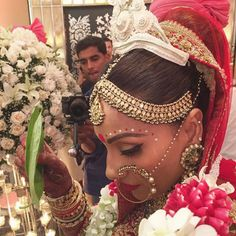 Bipasha Basu in in a Sabyasachi look on her wedding day - lehenga - matha patti - nath - nose ring - bengali bride