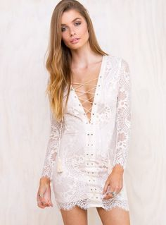 """The+Oracle+Dress+-+ Get+a+little+white+dress+in+your+life! Playful+tie-up+plunging+neckline Boho+dreamin'+lace+design Silking+nude+lining+for+extra+comfort Super+flattering+body+con+design Silver+zip+closure+at+back 100%+Polyester Length+of+size+8+shoulder+to+hem:+81cm Annalise+is+wearing+a+size+8  Annalise's+deets  Dress+size+8 Height:+173cm+(5'8"""") Bust:+81cm Waist:+61cm Hips:+86cm"""