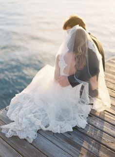 gorgeous shot at a beach wedding. Such an imtimate moment between the groom and bride.