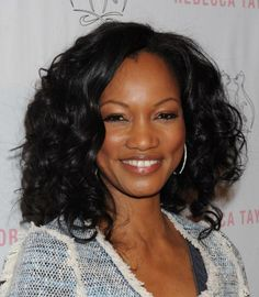 Garcelle Beauvais curly, shoulder-length hairstyle