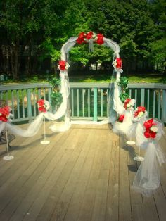 Red black wedding arch red black wedding wedding florist wedding arches tulle stands with tullefabric draping and topiaries for rent junglespirit Image collections
