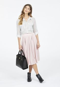 The most wanted bottoms of the season, this midi skirt will take you places! With pleated detailing that makes it oh so effortless, you'll love wearing this with your favorite heels....