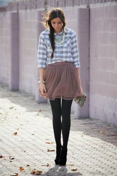 Casual (top) mixed with dressy (skirt, shoes, jewelry).