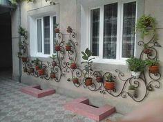 (for #Balcony) Green Home Decor: Beautiful idea for wall of #Patio, #Porch, Balcony with #Planters, Wrought Iron Jerelle Jordan via @sunjayjk
