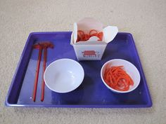 "transfer ""lo mein"" yarn noodles with chopsticks. H is for Homeschooling: Chinese New Year Tot Trays"