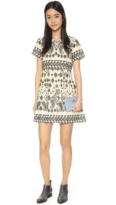 A romantic Sea dress with texture-rich eyelet embroidery. Pintucks add volume to the lined skirt. Self-tie straps at the back slit. Short sleeves.