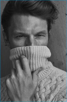 South African model Shaun DeWet dons a cable-knit turtleneck sweater from Massimo Dutti.