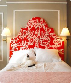 cool upholstered-headboard. can use inexpensive canvas cloth or a canvas drop cloth from the hardware store. Leave it natural or stencil designs on with cheap acrylic tubes of paint from Hobby Lobby!