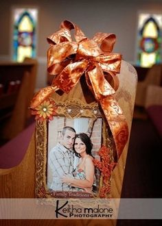 Pew decoration - although maybe words instead of pictures? Or pictures of family on their wedding days?