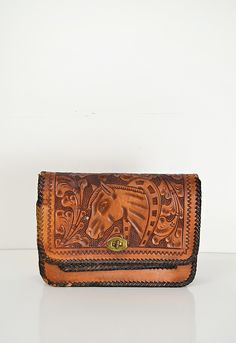 coming soon | vintage 1970s tooled leather horse clutch #1970s #leather #vintage