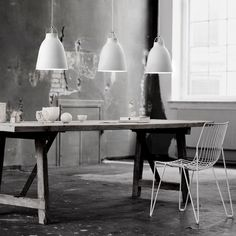 Creating a simple, soft design for small and large pendants was the main idea behind the Caravaggio series. http://www.ylighting.com/lightyears-caravaggio-matte-white-pendant-light.html
