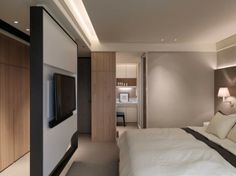 A Multilevel Contemporary Apartment By WCH Studio: The Bedroom With White Pillow Of A Multilevel Contemporary Apartment ~ Manningmarable