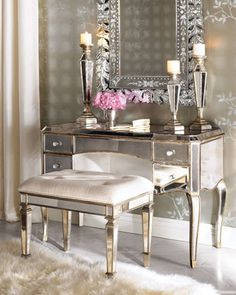 """Claudia"" Mirrored Vanity/Desk & Vanity Seat by Neiman Marcus. Handcrafted vanity seat is the perfect perch with its antiqued-finished mirrored apron and legs and upholstered ivory cotton cushion."