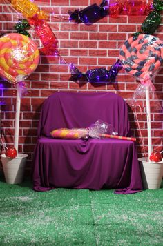 Willy Wonka's Winter Wonderland Photo Booth Backdrop - Made with foam swimming noodles, cellophane, fairy lights and clear plastic containers  #winterwonderland #candyland #candy #lollipops #DIY #sweets #willywonka #charlieandchocolatefactory #photobooth #backdrop #candylights