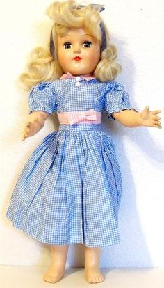 """1949-1953 Ideal Toni Doll hard plastic Vintage Doll Collector Doll Collectible      This 14"""" jointed body Ideal Toni doll has a glued-on Dupont nylon platinum hair wig. Her open/close eyes with upper lashes work fine."""