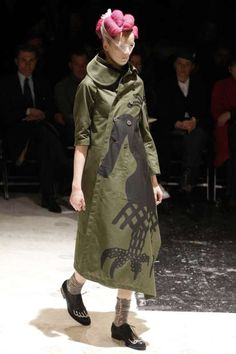 A model displays a creation by Japanese designer Rei Kawakubo for fashion house Comme des Garcons as part of her Fall/Winter 2009/10 women`s collection show during Paris Fashion Week March 7, 2009.