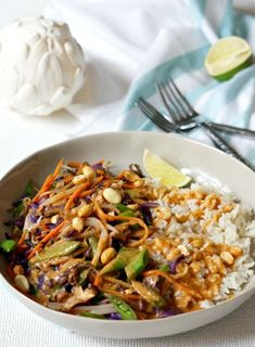 Colorful, flavorful and easy. These Thai Peanut Veggie Rice Bowls are freaking delicious! Mix and match your favorite veggies and add some grilled chicken or meat if you like. You'll wanna use the extra Thai Peanut Sauce on EVERYTHING! Veggie Rice Bowl, Vegetable Rice, Rice Bowls, Rice Dishes, Main Dishes, Veggie Fries, Veggie Stir Fry, Rice Recipes, Healthy Recipes