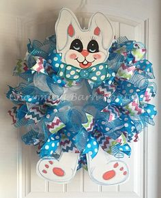 This adorable wreath would be such a cute addition to your spring and Easter decor. Made with 21in. white deco mesh and decorated with 10in blue deco mesh and 2 different wired ribbons throughout. Wooden, hand painted bunny head and legs added at top and bottom. This is a large wreath and measures 30 (from tip of ears to bottom of feet) x 27 x 8. Easter Rabbit Wreath, Easter Bunny Wreath, Easter Bunny, Easter Wreath, Mesh Spring Wreath, Easter Decor, Spring Decor, Spring Wreath  Each wreath…