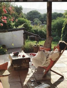 too bad we don't live in the South of France.  The 'found' furnishings are great, especially against that lush view.