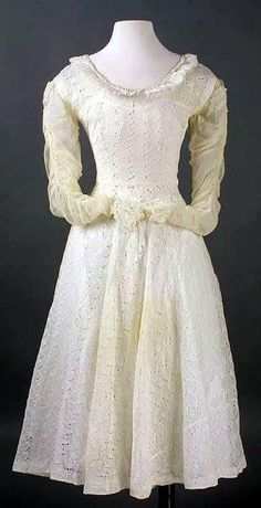 Norma Jeane's first wedding dress, made by her Aunt Anna Lower. She was only 16 when she married James Dougherty on June 16, 1942. It looks to have been shortened over the years.