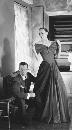 Charles James fitting a dress for Mrs. Randolph Hearst. Known for his obsessive attention to the fit of garments, James created gowns for several prominent socialites during his career.