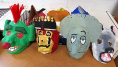 """Junior high students created 3-D masks in art class. They first created the mold for the masks using willing volunteers as """"models."""" Then, plaster strips were placed over the mold and the masks were painted. Awesome work, indeed!"""