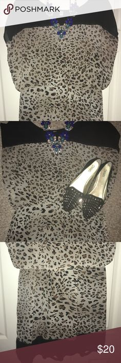 Leopard print sheath dress So comfy and airy for summer. Perfect with flats for work or heels for a date. The tag is missing but if fits like an XL/1X. Nothing at all wrong with this dress it's gorgeous Tacera Dresses Midi