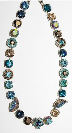 """MARIANA NECKLACE BLUE SUEDE SHOES: blue, topaz, gold, clear stones in silver setting, 16"""" adjustable chain"""