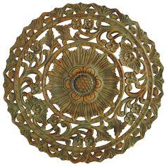 Our carved wood decor, substantial but lightweight, is just what your wall needs to make a statement. Intricately designed with a flower and vine motif and shaded a muted teal, it will add color to your neutral furnishings yet not overpower your window coverings, pillows or rugs. A fine statement, indeed.