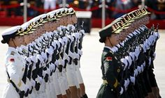 Female soldiers of China's People's Liberation Army march during the military parade.