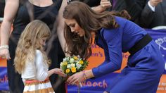 The Duchess of Cambridge speaks with Tilly Jennings as she leaves after her visit to the Treehouse, part of the East Anglia's Children's Hospices, in Ipswich, 29th September 2012