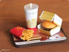 Miniature - Double Cheeseburger, fries and drink, all on a tray.