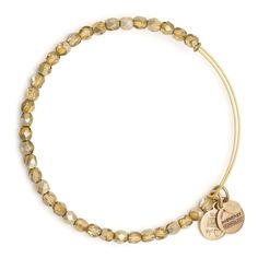 Gold Glisten Beaded Bangle | Alex and Ani- Inspired by freshly fallen snow that transforms the world into a glittering paradise, the Glisten Expandable Wire Bangle is a delicate circle of shimmering crystals that will stand out in any collection. Available in Ice, Slate, Cocoa, and Gold, the Glisten Expandable Wire Bangle shines with its own transformative radiance.