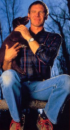 Harrison Ford and an adorable chocolate lab, my father's favorite dog breed. Harrison Ford Indiana Jones, Indiana Jones Films, Chris Miller, Tommy Lee Jones, Karl Urban, Cinema, Good Looking Men, American Actors, Handsome Boys