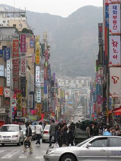 Streets of Busan, South Korea. The most densely built up areas of the city are situated in a number of narrow valleys between the Nakdong River and Suyeong River, with mountains separating some of the districts.
