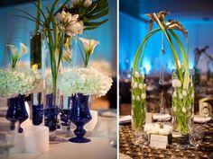 Google Image Result for http://photos.weddingbycolor-nocookie.com/p000003538-m172401-p-photo-450547/white-wedding-flowers-arrangements-vintage-blue-vases-wedding-reception-centerpiece.jpg