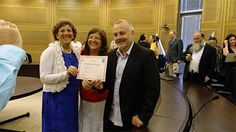 A founder of Be'ad Chaim Messianic Pastor Tony Sperandeo (right) and director Sandy Shoshani (left) hold a certificate from the Israeli government.