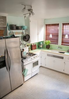 """Wow, this kitchen looks a lot like our """"new"""" 1940's kitchen. Inspiring!"""