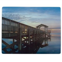 Sunset over the dock.  Sun Dog Cutting Boards with Original Artwork, Individually Created by the Artist, Available at Blue Pelican Gallery in Hatteras, NC