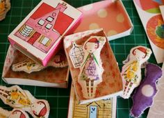 Matchbox dolls. I can see one that looks like Madeline with the house on the box cover.  Or Pippi Longstocking. Each with an appropriate accesssory inside.