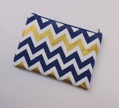 Handmade zipper pouch - chevron - gold and blue navy - bag organizer - phone pouch  Etsy https://www.etsy.com/listing/269970060/chevron-zipper-pouch-blue-navy-and-gold
