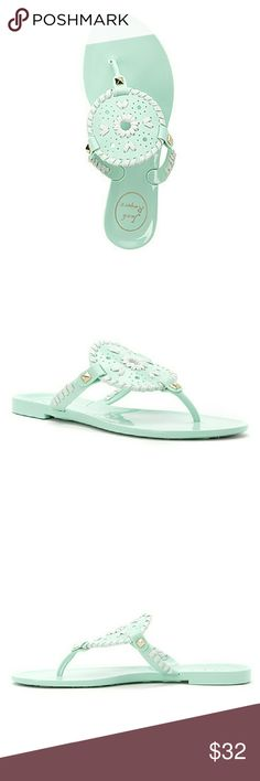 """Jack Rogers Mint/White 'Georgica' Jelly Sandals Made from a flexible rubberized synthetic material with a high-gloss finish. This slip-on flat sandal features a round, medallion-style center ornament and is accented with signature 'Navajo' whipstitching and pyramid rivets. Finished with a daisy-embossed synthetic sole. Approx. 1/2"""" heel height.    Condition: New without box. Jack Rogers Shoes Sandals"""